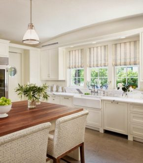 A charming neutral kitchen with stylish Roman blinds