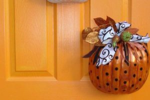 stylized pumpkins hanging on the front door