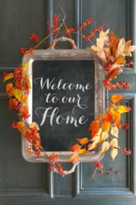 a welcoming frame with wreath of fall leaves