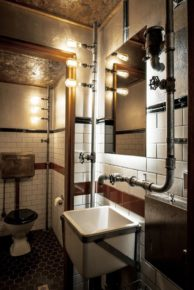 Bathroom with plumbing pipes