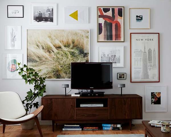 Numerous Paintings and Pictures Behind the TV #TV decor #home decor #homedecorimage