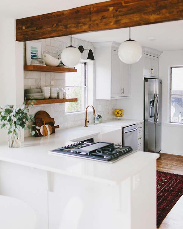 kitchen in white decorated with wooden elements