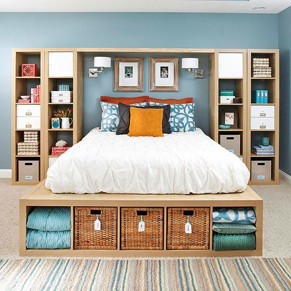 open wall cabinets on two sides of the bed