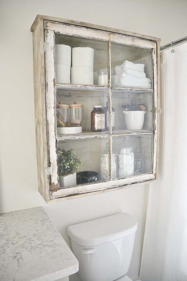 Upcycled Cabinet Bathroom Storage Idea #storage #toilet #bathroom #homedecorimage