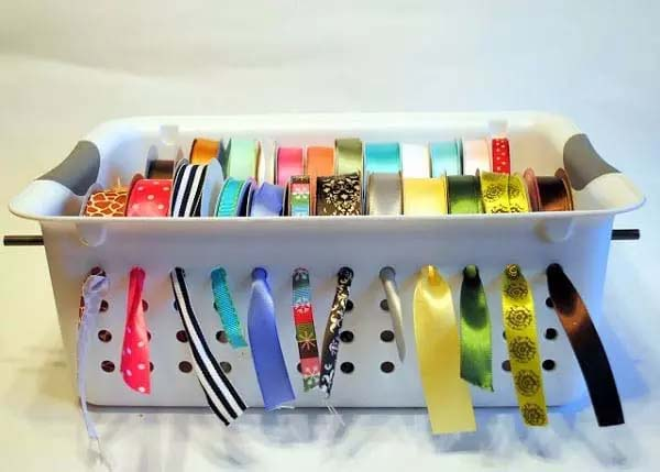 Hanging Ribbons in a Slotted Tupperware Bin #Christmas #Christmas decoration #storage #homedecorimage